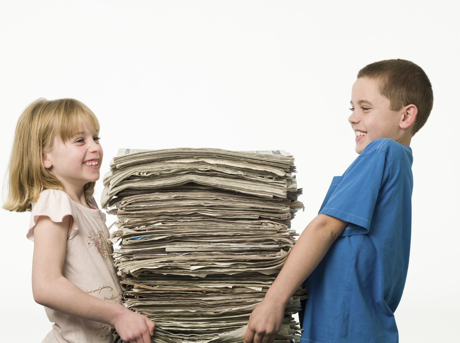 Children carrying Newspapers.